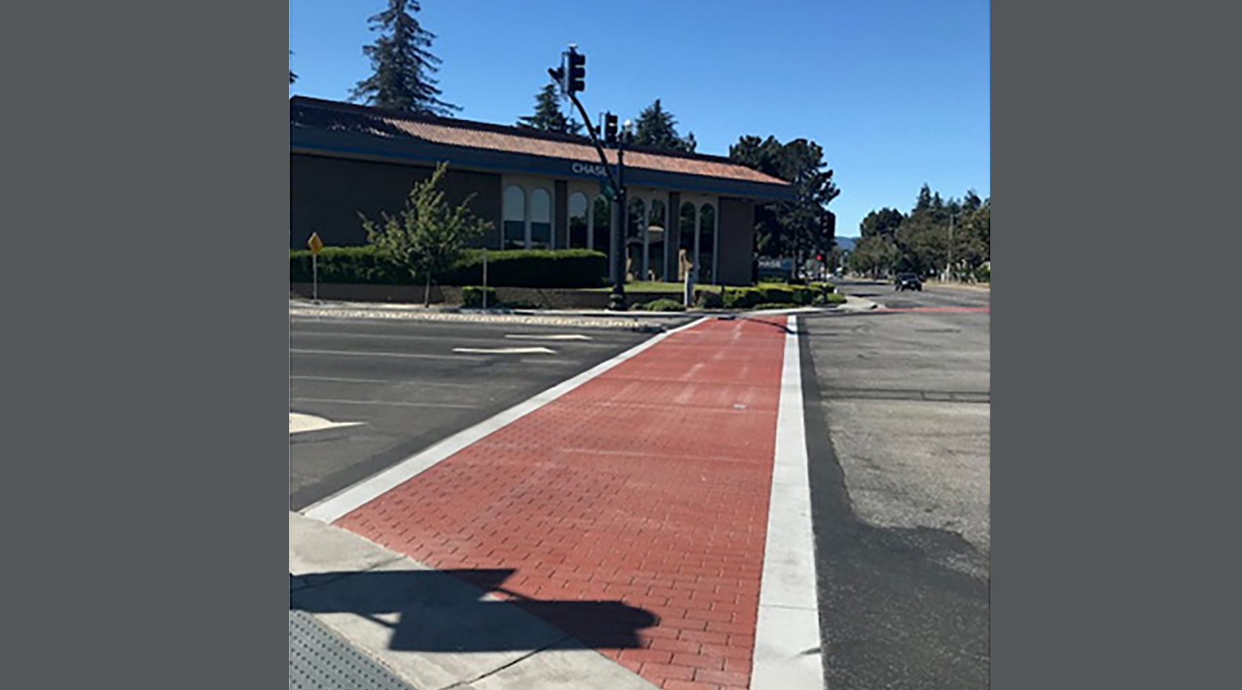 Stamped AC crosswalk at Iowa/Mathilda intersection with new traffic signal pole and handicap ramps.