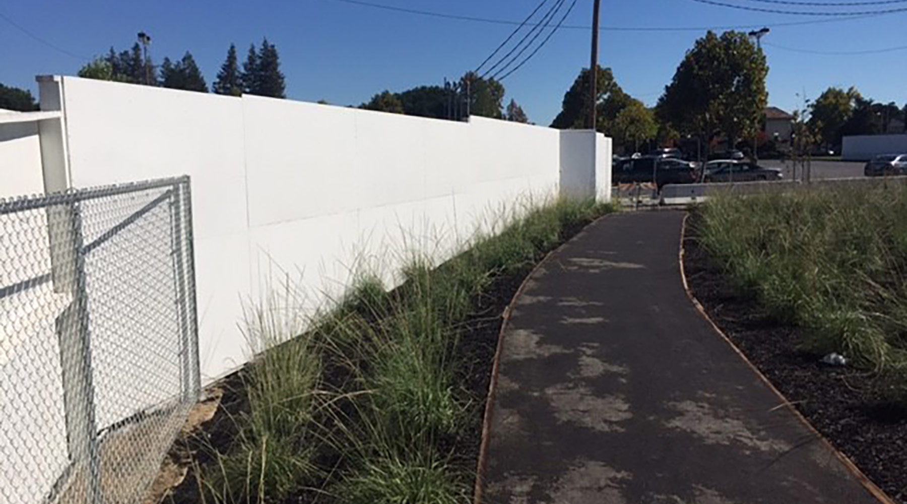 New fence installed and painted; chain link fence installed to protect drop at Macy's loading dock