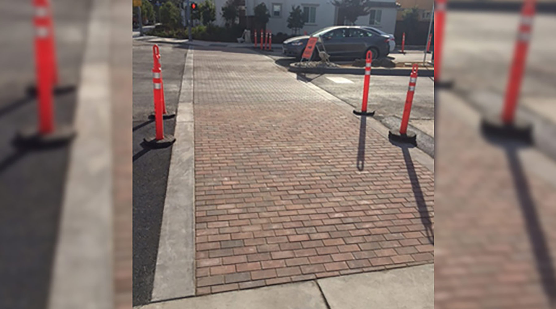Feb 2018: East Iowa/Taaffe paver crosswalk complete with concrete bands.